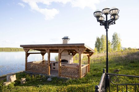 summer gazebo for barbecue and barbecue with stove