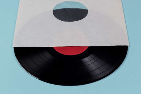 record cover: vinyl record insied the cover isolated on blue background