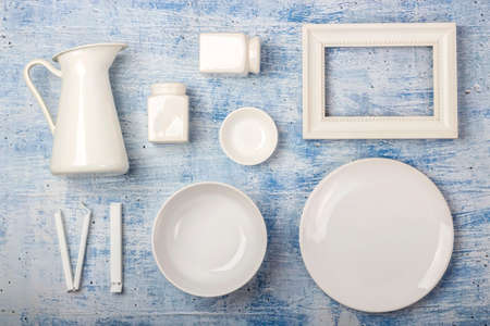 Top view on rustic table arrangement of different dishes and utensils with space for text
