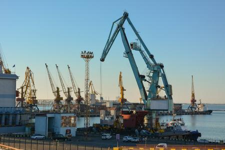dockside: Dockside cranes on a background of blue sky