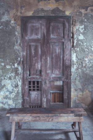bangrak: Blur old wooden door.Vintage tone.