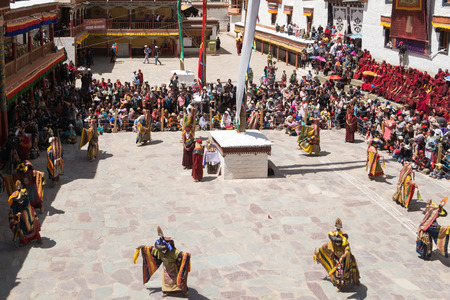 tantric: Leh Ladakh,India - July 7,2014 : Lamas monks perform mask dances in Hemis Festival 2014 at Hemis Monastery. Editorial
