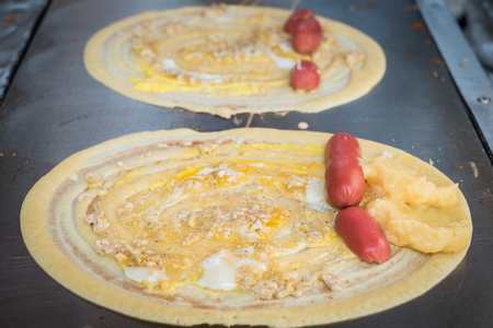 sweetmeat: Khanom Tokyo is a thin flat pancake filled with sweet custard cream. Some have a savory filling, like pork or sausage. It is a Thai street snack