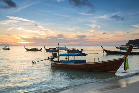 seaside: Long tail boats with sunrise sky in Koh Lipe Island