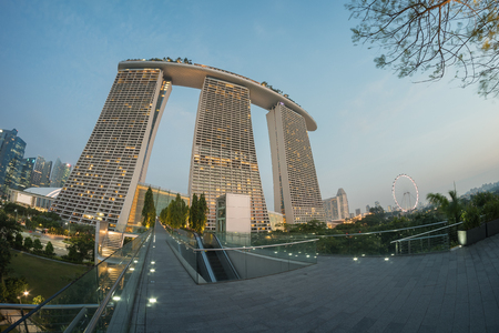standalone: SINGAPORE - March 18, 2016 : Marina Bay Sands Hotel is an integrated resort fronting Marina Bay in Singapore. Developed by Las Vegas Sands, it is billed as the worlds most expensive standalone casino property at S$8 billion