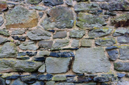 briks: An ancient stone wall made out of briks and rocks