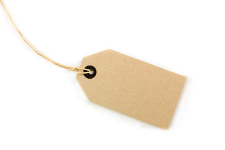 A Blank tag tied with brown string. Price tag, gift tag, sale tag, address label, etc.