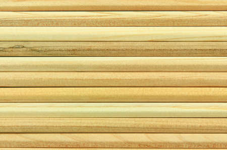 Horizontal wooden pencil poles forming a background texture photo