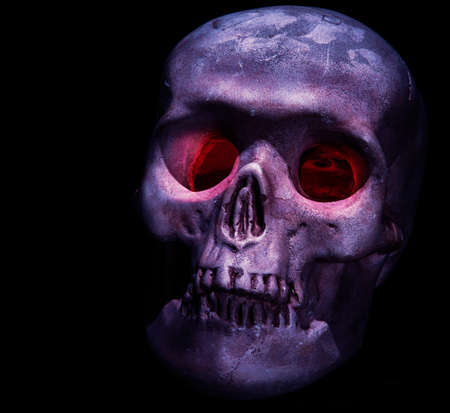 eye socket: A creepy skull head with red eyes on black background