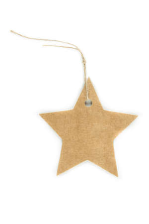 A paper star tag with string isolated on white photo