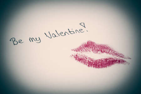 happyness: Be my valentine written on lined paper with kiss Stock Photo