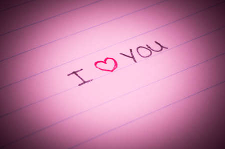 I love youwritten on lined paper with a little red heart Stock Photo