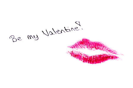 Be my valentine written on paper with a kiss of lipstick