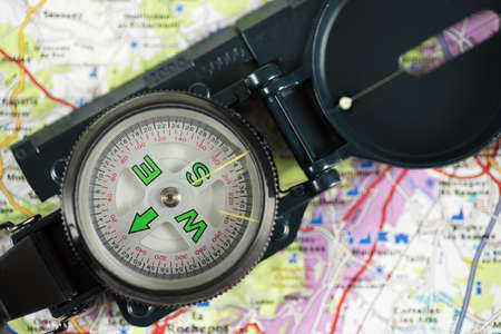 A compass on a map to chart the right path