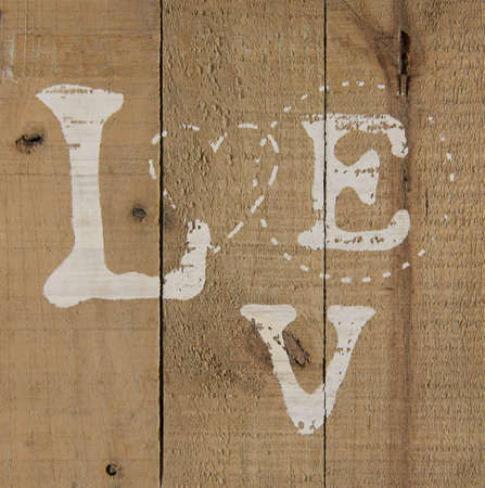 A background of wood with love text painted on it