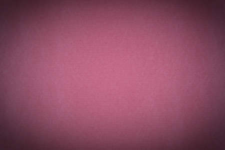 A background of pink paper texture with vignette Stock Photo