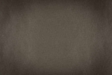 A background of dark brown paper texture with vignette Stock Photo
