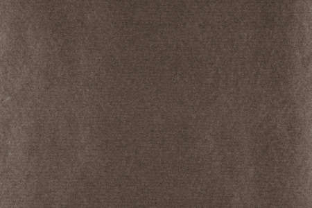 A background of dark brown paper texture