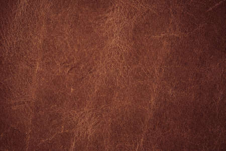 wallpaper pattern: A background texture of brown colored leather
