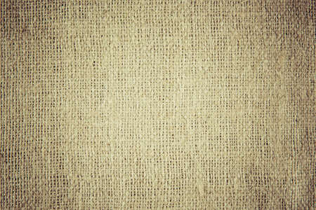 A background texture of burlap cloth yellow vignette Stock Photo