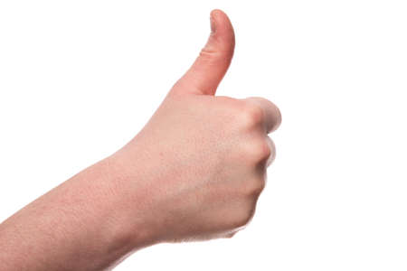 A male hand sticks a thumb up isolated on a white background