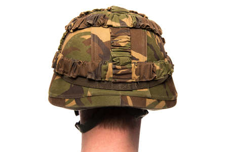 The backside of a male head with a army helmet isolated on a white background