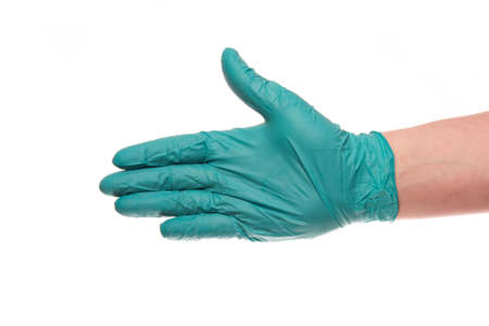 latex glove: A hand of a man in a green latex glove gives a hand isolated on a white background Stock Photo