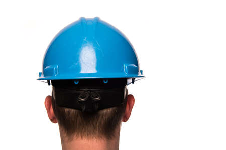 The backside of a male head with a safety helmet isolated on a white background Stock Photo