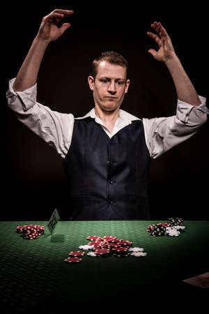 gambler: A male gambler is upset after losing and throw the cards away Stock Photo
