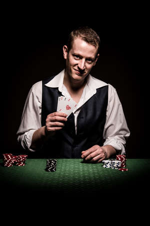 gambler: A male gambler makes four aces and winning hand Stock Photo