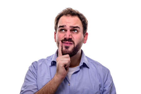 Man with questioning look in his eyes and finger on his cheek Stock Photo