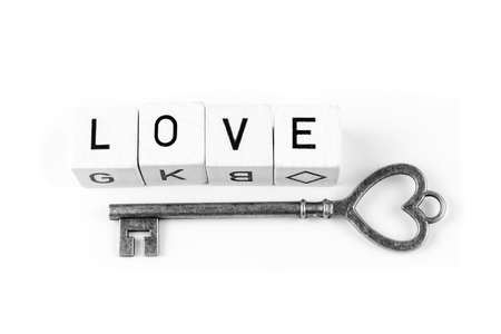 The word love and a key, black and white style Stock Photo
