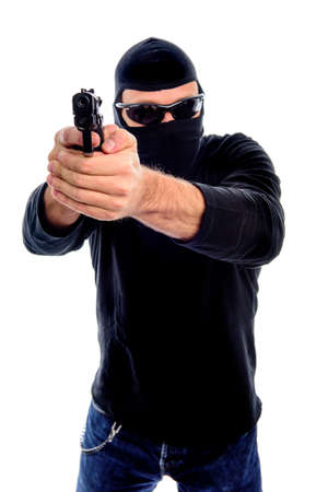Man with mask, sunglasses and gun isolated on a white background