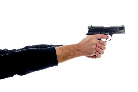 Two arms outstretched holding a gun firmly with a finger on the draw Stock Photo - 52650144