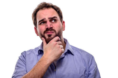 Man with questioning look in his eyes and hand on his chin