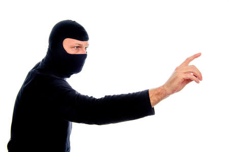 Man with mask and finger in the air, concept for internet criminal, hacker and cybersecurity Stock Photo - 52650153