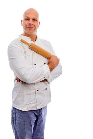 Baker with rolling pin to his chest in baker dress with a professional look