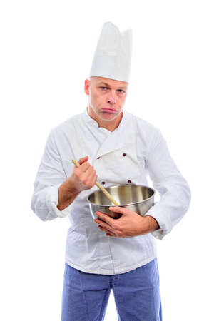 A heavy tired cook stirring with a wooden spoon in a bowl, concept for pressure at the workplace Stock Photo - 52650155