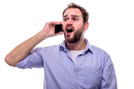 Cheerful man with beard singing with his cell phone to his ear Stock Photo - 52650177