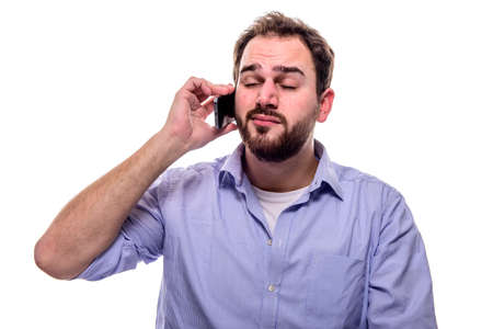 Man listening to cell phone from his ear and eyes closed, exudes confident out Stock Photo