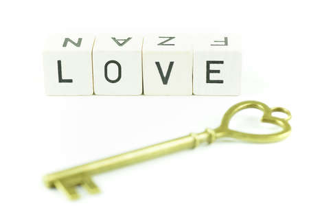 The word love and a key, limited depth of field Stock Photo - 54231837