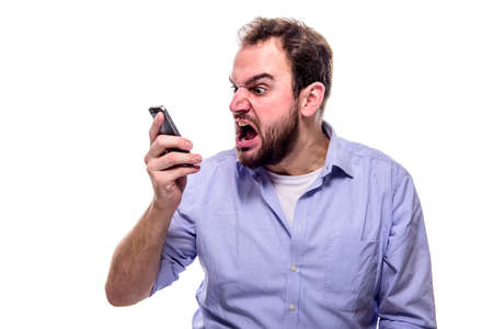 A businessman shouting into his phone, concept of anger, aggression and stress in the workplace