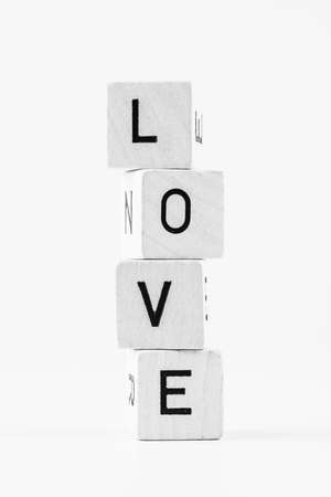 The word love made of stacked cubes Stock Photo