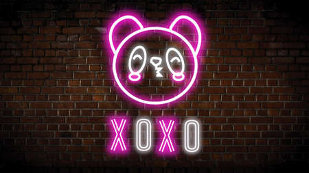 Xoxo neon sign  on a brick wall Stock Photo