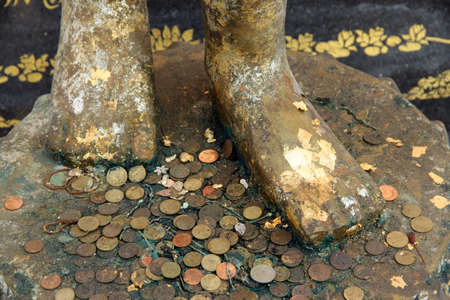 coin toss: feet of buddha image and forecast coins