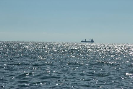 catchlight: sparking blue sea ,blue sky and a ship