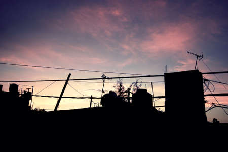 Silhouette of building against sunset