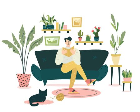 Guy is sitting on the coach and reading an interesting book in cozy and nice living room. Black cat is sleeping on the carpet around him. A lot of different plants on the background.