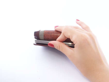 Womans hand holding wallet photo