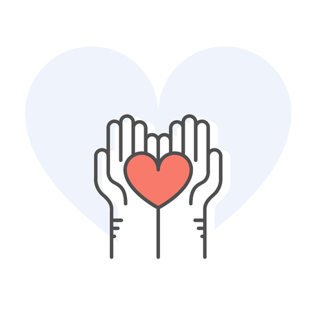 Helping hands holding heart - charity, donation and volunteer help concept